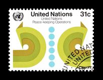 Postage stamp printed by United Nations. That Promotes Peace keeping operations, circa 1980 royalty free stock photos