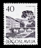 Postage stamp printed by Yugoslavia. Cancelled postage stamp printed by Yugoslavia, that shows Sarajevo, circa 1965 royalty free stock images
