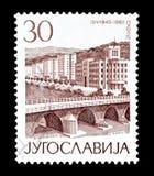 Postage stamp printed by Yugoslavia. Cancelled postage stamp printed by Yugoslavia, that shows Skopje, circa 1965 stock photos