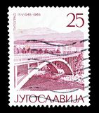 Postage stamp printed by Yugoslavia. Cancelled postage stamp printed by Yugoslavia, that shows Titograd, circa 1965 stock photography