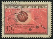 Postage stamp. RUSSIA - CIRCA 1959: stamp printed by Russia, shows globe and rockets, circa 1959 royalty free stock image