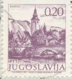 Postage stamp. The scanned stamp. The Yugoslavian stamp. The bridge through the river stock photos