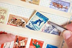 Postage stamp with skier on album Stock Photos