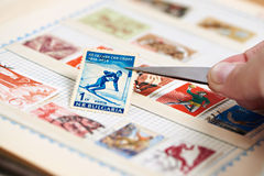 Postage stamp with skier on album Stock Photography