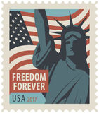Postage stamp with Statue of Liberty and flag USA. Postage stamp with New York Statue of Liberty, the flag of United States of America and the word freedom Stock Images