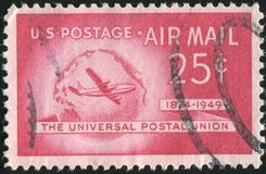 Postage stamp. UNITED STATES - CIRCA 1949: stamp printed by United states, Boeing Stratocruiser and Globe, circa 1949 royalty free stock image