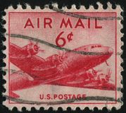 Postage stamp. UNITED STATES - CIRCA 1946: stamp printed by United states, shows airplane DC-4, circa 1946 royalty free stock image