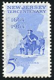 Postage stamp. UNITED STATES - CIRCA 1964: stamp printed by United states, shows Philip Carteret Landing at Elizabethtown and map of New Jersey, circa 1964 stock photo