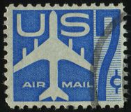 Postage stamp. UNITED STATES - CIRCA 1969: stamp printed by United states, shows Silhouette of Jet Airliner, circa 1958 royalty free stock photo