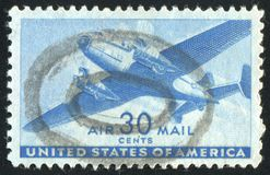 Postage stamp. UNITED STATES - CIRCA 1939: stamp printed by United states, Twin-Motored Transport Plane, circa 1939 royalty free stock photography