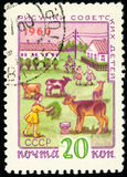 Postage stamp of the USSR - Figures of children about the collec. Pioneer girls feed village calves with green grass Royalty Free Stock Photos