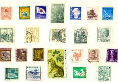 Postage Stamps. A collection of postmarked international postage stamps stock image