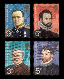 Postage Stamps. Robert Falcon Scott, Martin Frobisher, Henry Stanley,  Francis Drake (isolated on black Stock Photos