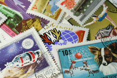 Postage stamps. Pile of old postage stamps from Mongolia and USSR Royalty Free Stock Images