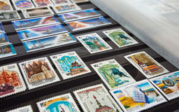Postage stamps in album. Stock Images