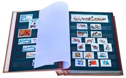 Postage stamps in album. Stock Photos
