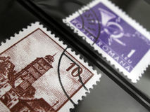 Postage stamps in album. An image of two postage stamps in a stamp collecting album for display purpose. Horizontal format. Nobody in picture royalty free stock photos