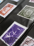 Postage stamps in album Stock Images