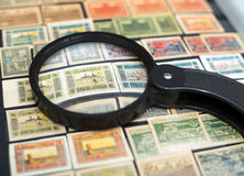 Postage stamps of Azerbaijan. Under a magnifying glass royalty free stock image