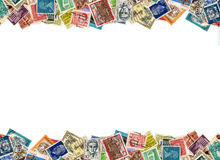 Postage stamps border. Postage stamps from many different countries, copy space stock photos