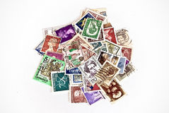 Postage stamps of different countries. Postage stamps belonging to different countries of the globe Stock Photos