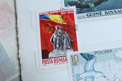 Post stamp Galati, Romania Communism statue. Postage stamps, Galati Romania, Romania Communism statue and flag Stock Photos