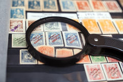 Postage stamps of Georgia. Under a magnifying glass royalty free stock photos