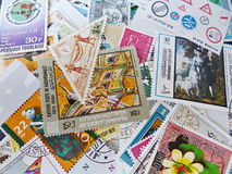 Postage stamps. Mix different postage stamps from different countries. Signs also have different sizes royalty free stock images