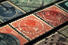 Postage stamps of the Netherlands and Belgium early twentieth century. Shallow depth of field stock photo
