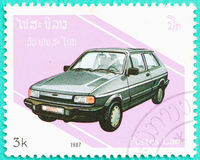 Postage stamps with printed in Laos shows car. SARABURI, THAILAND-JUNE 04,2017: Used Postage stamps with printed in Laos shows Datsun,circa 1987 Stock Image