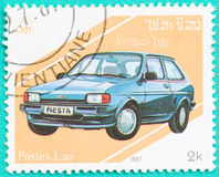 Postage stamps with printed in Laos shows car. SARABURI, THAILAND-JUNE 04,2017: Used Postage stamps with printed in Laos shows Ford Fiesta Mark 2,circa 1987 Stock Photo