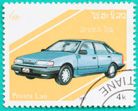 Postage stamps with printed in Laos shows car. SARABURI, THAILAND-JUNE 04,2017: Used Postage stamps with printed in Laos shows Vauxhall Cavalier Mark 3,circa Stock Photos