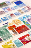 Postage stamps with selective focus. Postage stamps in a album with selective focus Stock Photos