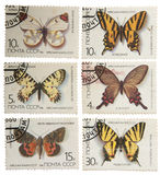 Postage stamps of the USSR, with the image of butterflies isolat Stock Photos