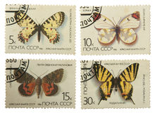 Postage stamps of the USSR, with the image of butterflies isolat Stock Images