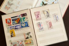 Postage stamps in a vintage album. royalty free stock photo