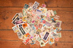 Postage stamps. Postage stamps on a wooden background Stock Image