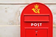 Postal box. Red postal box against grunge wall in Copenhagen, Denmark Royalty Free Stock Images