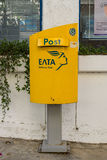 The Postal Box of the State Postal Service Hellenic Post. CRETE, GREECE - JULY 11, 2016: The Postal Box of the State Postal Service Hellenic Post on a street in Stock Photos
