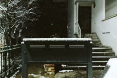 Postal boxes in front of the house Stock Photography