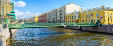 The Postal Bridge in St Petersburg. The Pochtamtsky Bridge (Postal) is a cast-iron pedestrian suspension bridge across the Moyka River, named after Central Post Royalty Free Stock Image