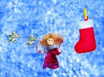 Postal con ángeles y un calcetín Foto de archivo libre de regalías