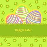 Postal con los huevos de Pascua pintados en rayas Foto de archivo libre de regalías