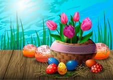 Postal con los tulipanes en una cesta de mimbre, los huevos de Pascua y las magdalenas en una tabla de madera contra la perspecti libre illustration