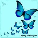 Postal con un feliz cumpleaños, muchas mariposas azules en un azul libre illustration