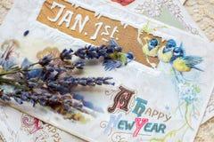 Postal de la Feliz Año Nuevo con las flores foto de archivo libre de regalías