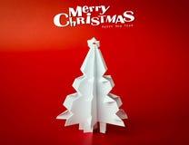 Postal de la Navidad con el árbol de navidad de papel verdadero Foto de archivo