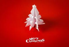 Postal de la Navidad del vintage con la Navidad de papel verdadera Imagen de archivo