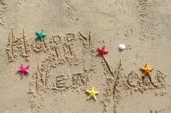 Postal de la playa de la Feliz Año Nuevo Fotografía de archivo