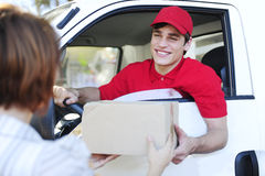 Postal delivery courier delivering Royalty Free Stock Photo